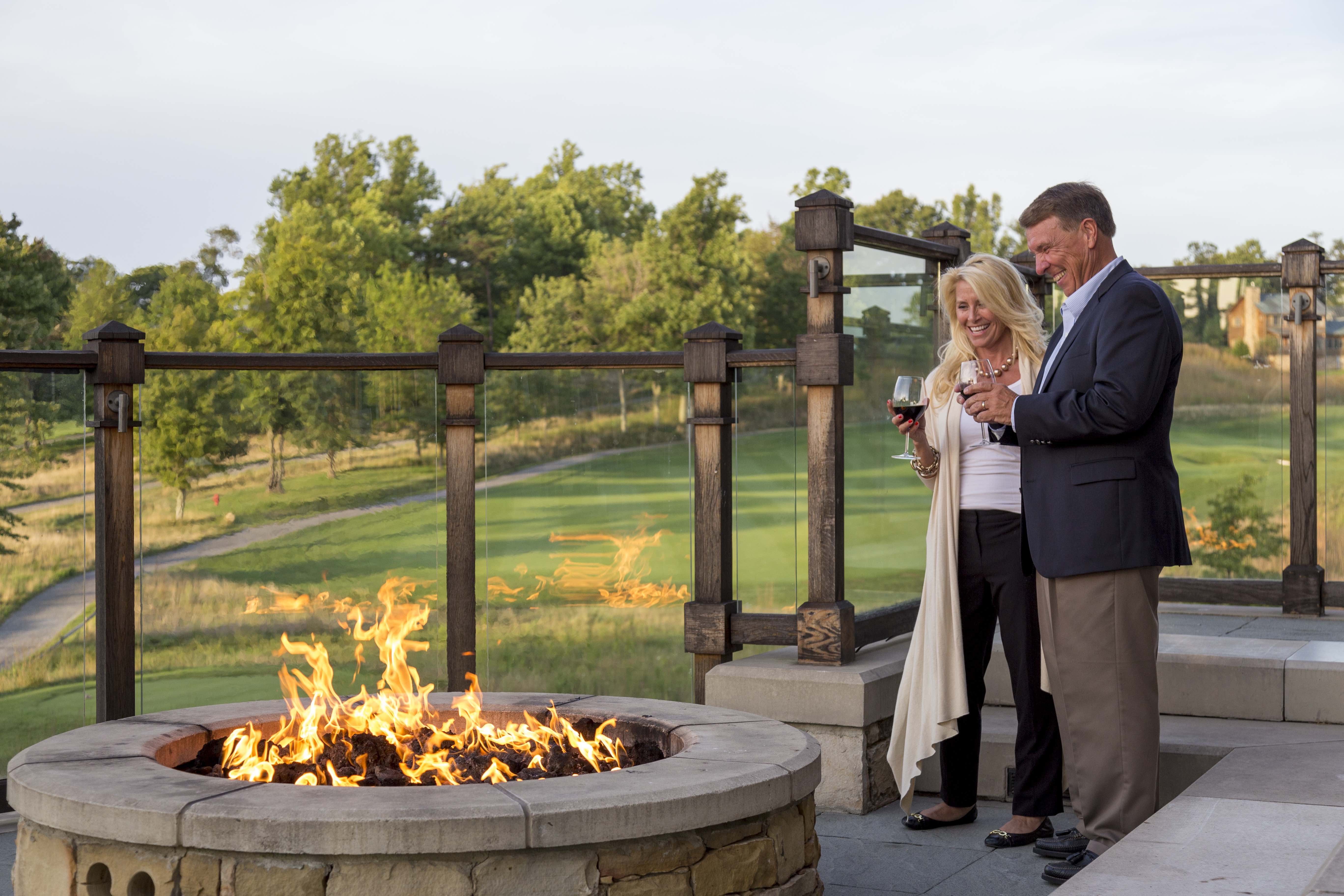 A couple standing in front of the firepit at Primland resort.